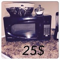 New microwave hardly used , coat hanger, and coffee maker