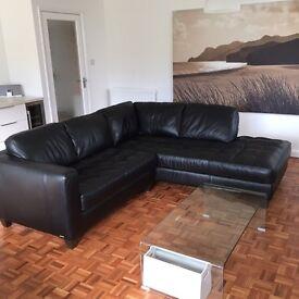Natuzzi Black leather right hand chaise corner sofa