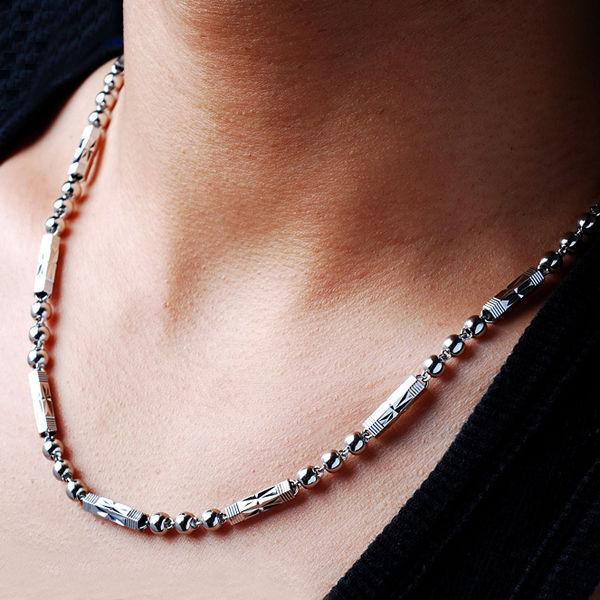 Men wearing necklaces
