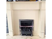 Living flame gas fire and surround