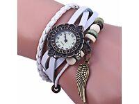 Retro Women Woven Bracelet Quartz Watch Leather Strap Wing Pendent