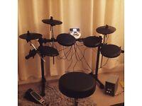 Alesis DM7X + drumstick, headphones and seat
