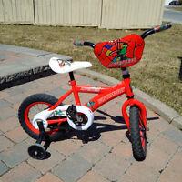 Boy's Bike with training wheels plus helmet - mint condition