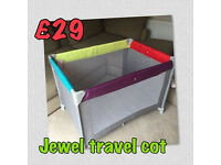 HAUCK TRAVEL COT BRAND NEW IN BOX WITH MATTRESS IN GORGEOUS UNISEX JEWEL COLOURS. FOLDS AWAY SMALL