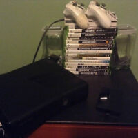 Xbox 360 2 controllers and 14 games trade obo
