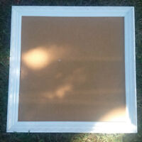 cork board with pretty white picture frame border