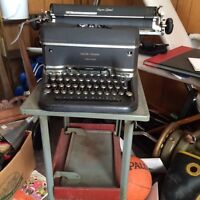 Two old typewriters  one with stand one with out