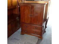 Solid wood reproduction style tv unit.