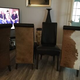 Leather and hide dinning chairs