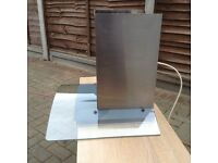 Induction hob and curved glass extract hood