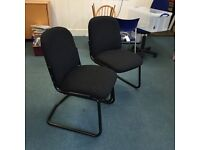 2 black office chairs