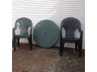 GREEN PLASTIC TABLE AND FOUR CHAIRS