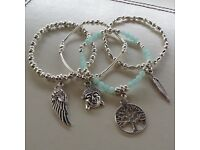 Set of four silver plated stacking Brad bracelets
