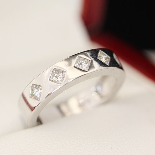 5 stone Diamond engagement ring, wedding band. With 5 diagonally set princess cu