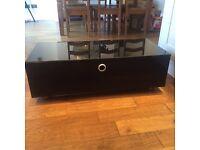 Black mirrored glass tv unit