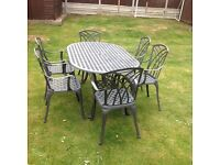 CAST ALUMINIUM GARDEN TABLE AND 6 CARVER CHAIRS GREY