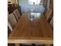 Light oak dining room table and 6 high back chairs