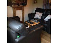 X2 dark brown leather sofas