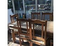Solid Indian wood dining table and chairs