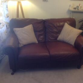 Two real leather large two seater sofas REDUCE £300.