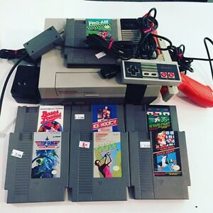 NES, zapper, and 7 games  $75