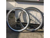 A pair of bike wheels alloy 700c used