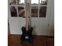 Squier by Fender Telecaster Custom.