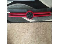 Golf mk4 front grill with black badge little bit of paint peel on badge
