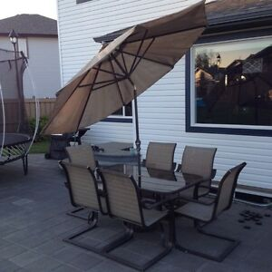 Patio table with umbrella & Six Chairs