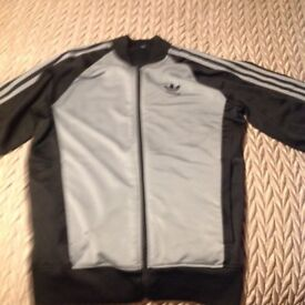 Adidas sports / track suit top