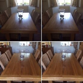 Light Oak dining table with 6 high back chairs - ideal for Christmas lunch with family and friends