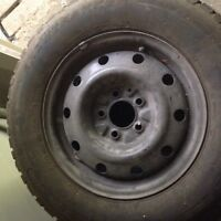 4 WINTER tires on rims 215 70R15 in excellent condition.