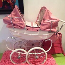 Pink twin double Silvercross pram