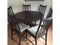 Ercol dark wood round table with 6 chairs very good condition