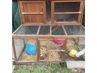 Rabbit hutch with attached run