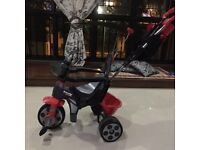 AS NEW CHILDS TRIKE WITH PARENT HANDLE/HOOD