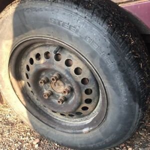 4 tires 2 are 185-65-14 2 are 195-70-14