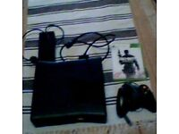 Xbox 360 Slim, 4gb, Black, with controller, all wires, play & charge kit, and modern warfare 3.