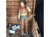 Antique cowboy statues