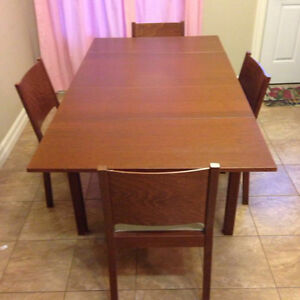 Brown Wooden Expandable Table and Chairs