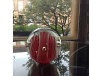Large red glass paperweight.