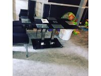 BARGAIN!!! Black glass dining room table an 6 chairs 2 months old RRP £600