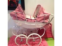 Pink twin Silvercross dolls pram