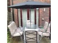 NEW 6 seater table, 6 chairs with full cushions and crank and tilt parasol