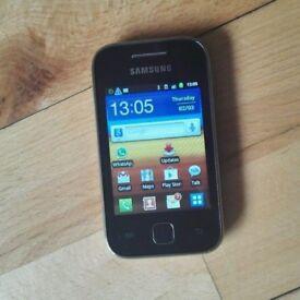 Samsung Galaxy Y Android smartphone in black, excellent condition