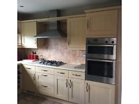 Kitchen with Bosch integrated oven, sink, hob and extractor fan