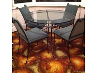 M&S glass table and four chairs for sale