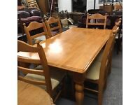 Large heavy solid wood dinning table and six chairs