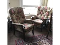 Pair of high back, floral patterned arm chairs