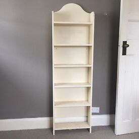 Tall thin solid wood shelving unit painted cream shelves